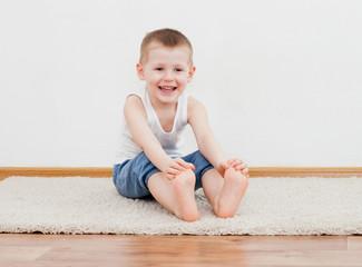 Kid doing yoga relaxing exercise