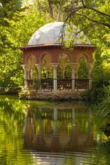 Romantic pavilion reflected in a pond. Sevilla, Spain