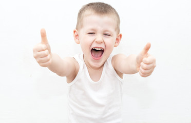 Cheerful boy with thumbs up