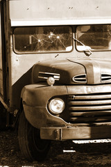 Old classic abandoned truck in sepia color