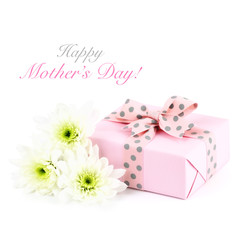 Mother's day greeting card with gift and flowers on white