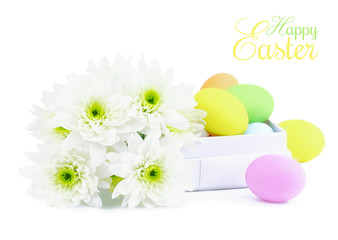 Happy Easter greeting with flowers and colourful Easter eggs
