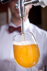 beer being poured from a beer tap