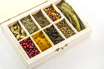 set of spices in a wooden box, spices in the sections