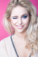 Young attractive blonde winking woman expressive portrait
