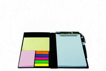 A black leather executive folder on timber desk with sticky note