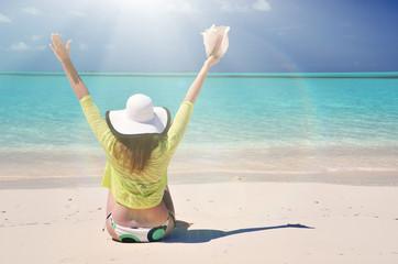 Girl at the ocean. Great Exuma, Bahamas