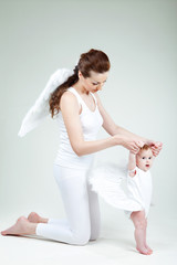 Beautiful woman with a baby angel