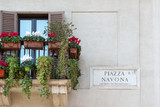 Piazza Navona sign on historic italian building in Rome - 79843775