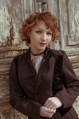 Retro portrait red haired women vintage coat obsolete background