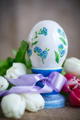 Decorative easter egg with a bouquet of spring tulips