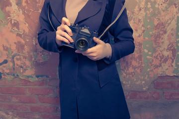 Girl with camera.Vintage. Women holding retro photo camera.
