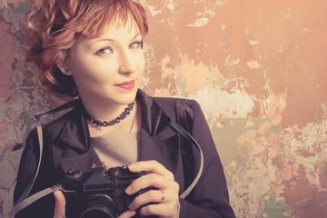 Hipster red haired woman retro film camera