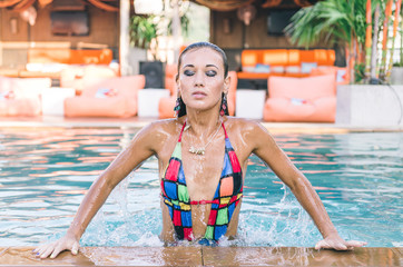 beautiful model getting out the water