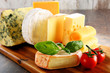 Different sorts of cheese on kitchen table - 79847914