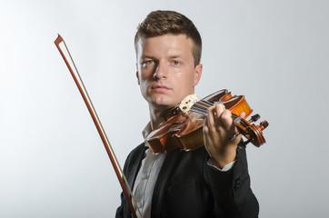 Violinist in dark tuxedo