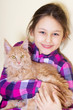 smiling child and kitten