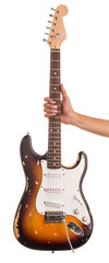 Hand holds electric guitar.