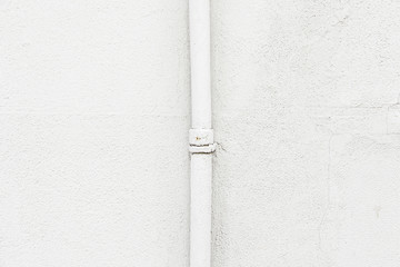White wall with a pipe