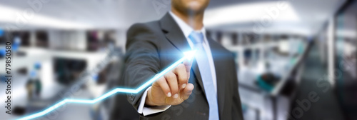 Businessman in his office using tactile interface - 79850580