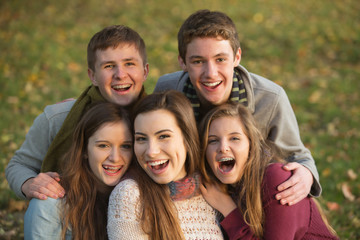Five Laughing Teens Outdoors