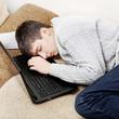 Young Man sleep on Laptop