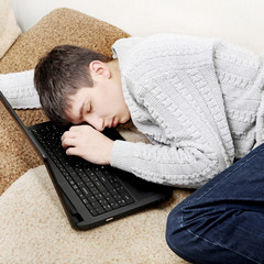 Young Man sleep on Laptop