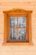 Window with thread in a wooden house