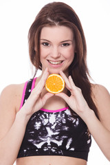 Healthy sporty girl with orange