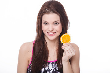 Healthy fitness girl with orange