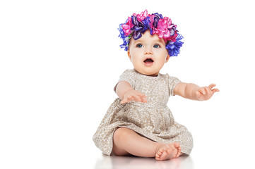 Beautiful little girl wearing a wreath