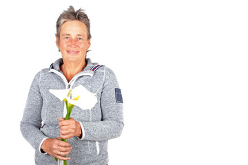 Beautiful mature woman with blossoming cala flowers