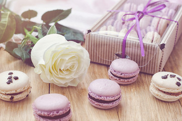 Lilac macaroons with rose and gift box