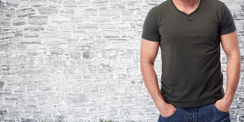 Man over grey wall background.