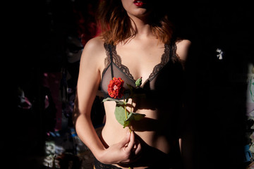 Female body with red rose.