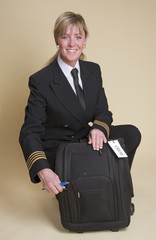 Female airline pilot checking contents of her flight bag