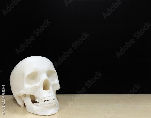 Leinwandbild Motiv Skull Made by 3D Printer on The Wooden Table at the Left Corner