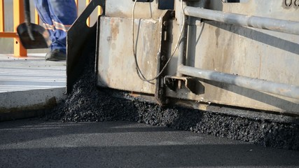 Applying a new layer of asphalt on the highway.