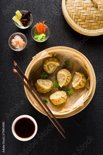 Dim sum dumplings in steamer and ingredients top view - 79854981