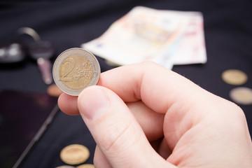 mans hand holding money