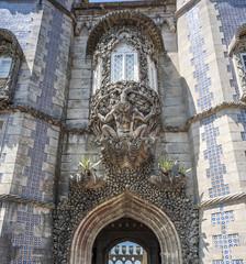 Portugal , Sintra . Castle Pena, Triton  over the lancet arch