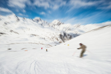 Speed skiing in alpine resort, radial blurred effect