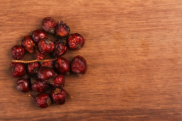The dry rosehip on the wood