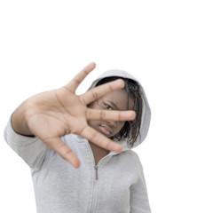 Rebel preteenager wearing a hooded sweatshirt, isolated