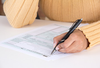 Person filing IRS tax form