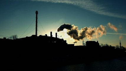 Colorized toned footage industry power plant against sunset at
