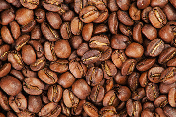 Spilled Brown coffee beans.  background texture