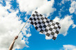 Checkered flag waving in the wind - outdoors shoot - 79863327