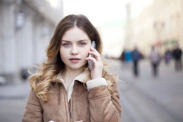 Beautiful young blonde calling by phone