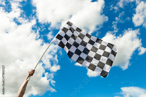 Fotobehang Formule 1 Checkered flag waving in the wind - outdoors shoot